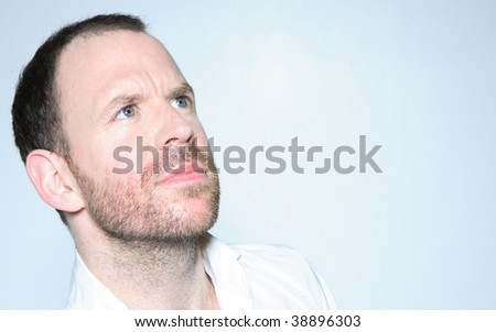 man looking up into copy space