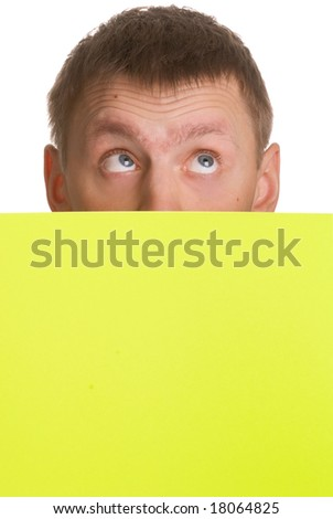 Man looking up over a yellow card isolated on white background - stock photo