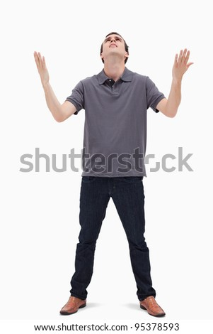 Man looking up to the heavens against white background - stock photo