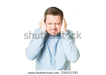 Man looking upset because of the noise