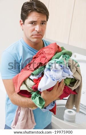 Man looking upset Doing Laundry - stock photo