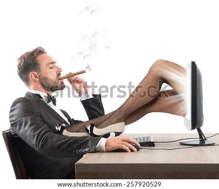 Man looks erotic sites of beautiful girls - stock photo