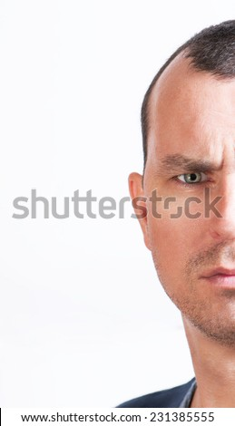 man looks in the camera half face close up - stock photo