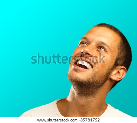 man lucky face on a blue background - stock photo