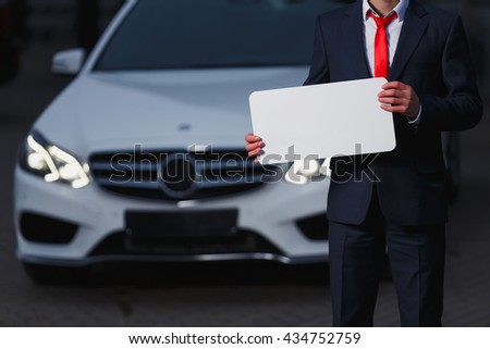 Man luxury cars dealer. It keeps holding plate. You can add your design. MOCK-UPS