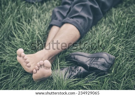 Man lying on the grass   - stock photo