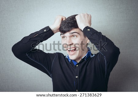 man made a mistake and tears his hair - stock photo