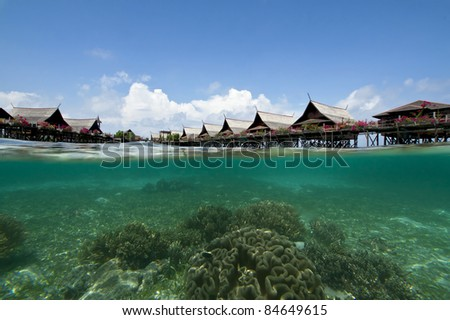 Man-made Kapalai's resort with exotic coral through underwater camera - stock photo