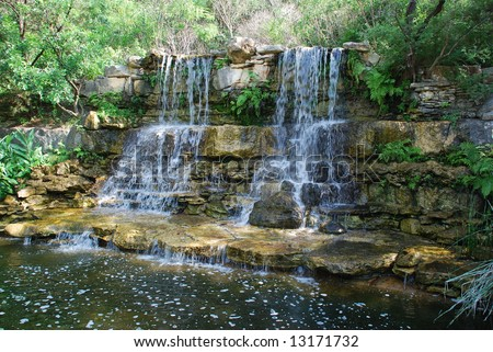 man made waterfall at Austin, Texas Zilker botanical gardens - stock photo