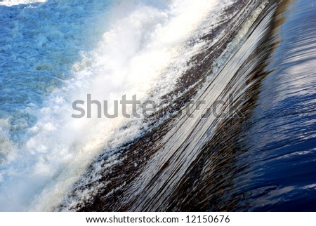 Man made waterfall on a river - stock photo