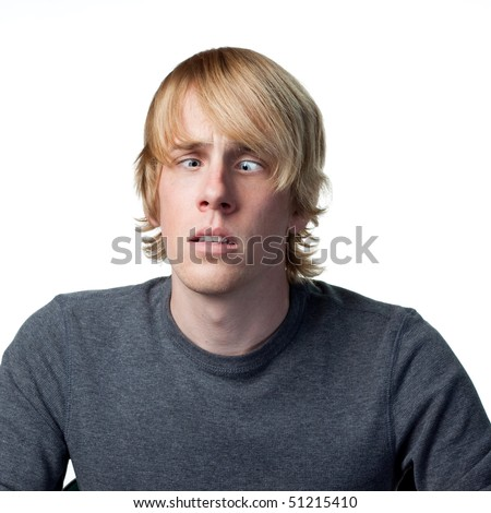 Man makes a funny face to the camera, isolated image