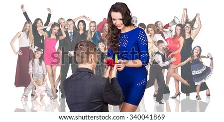 Man makes a proposal his girlfriend foreground on the people crowd background - stock photo