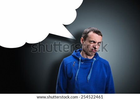 Man makes faces while thinking about something - stock photo
