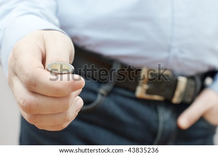Man making a choice by throwing small coin (drawing of lots) - stock photo
