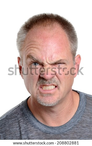 man making a face isolated white background - stock photo