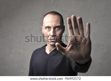 Man making a halt sign with his hand