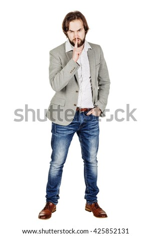 man making a shushing gesture raising his finger to his lips. emotions, facial expressions, feelings, body language, signs. image on a white studio background. - stock photo