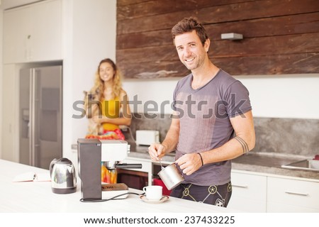 Man making coffee for his girlfriend - stock photo