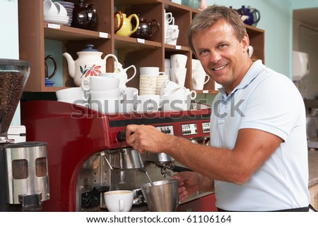 Man Making Coffee In Cafe - stock photo