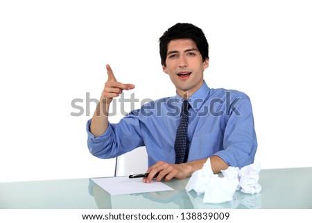 Man making fun of somebody - stock photo