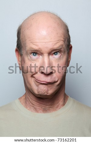 Man making funny face and grimacing - stock photo