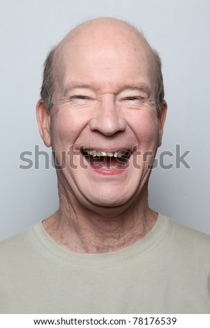Man making funny face showing teeth - stock photo