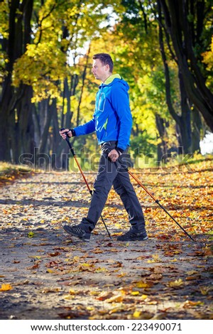 man making nordic walking in the park