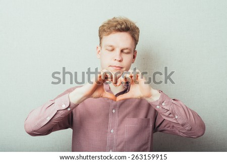 man making out of the hands heart - stock photo