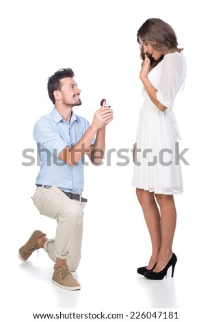 Man making propose with wedding ring in gift box. isolated on white background - stock photo