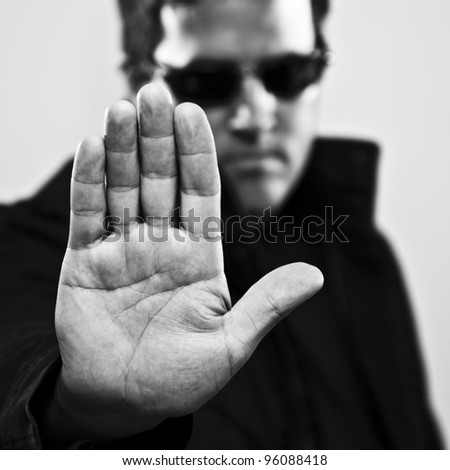 Man making stop gesture - stock photo