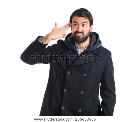 Man making suicide gesture