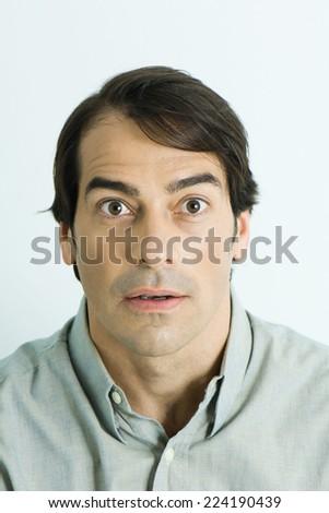 Man making surprised face, portrait - stock photo