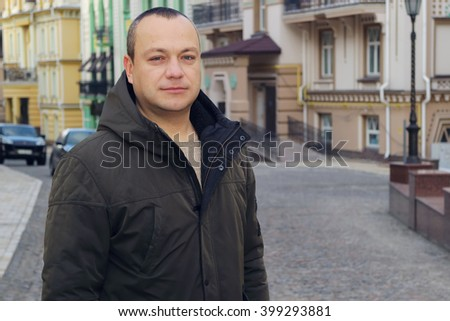 Man. Male portrait against the backdrop of the city. - stock photo