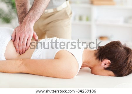 Man massaging a cute woman in a room - stock photo