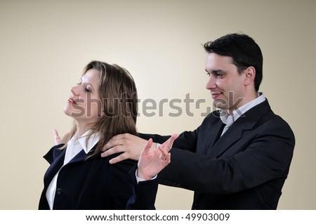 man massaging business woman - stock photo