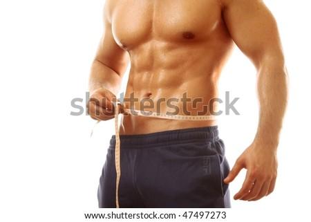 Man, measurement tape - stock photo