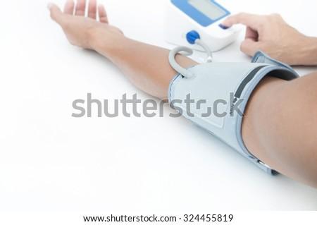 Man measures blood pressure - stock photo