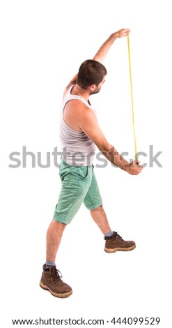 man measures the wall with a tape measure - stock photo