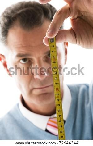 Man Measuring, close-up - stock photo