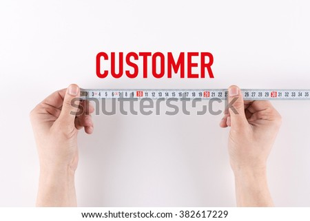 Man measuring CUSTOMER - stock photo