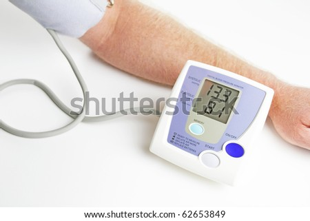 Man measuring his own blood pressure. - stock photo