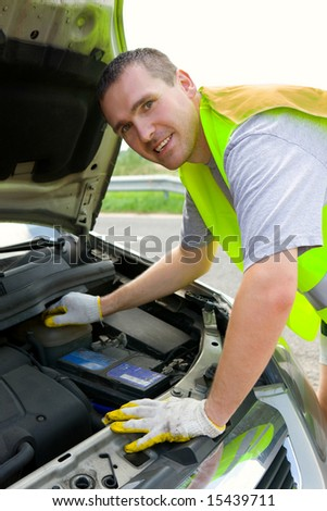 Man mechanic repairing his car on the road - stock photo