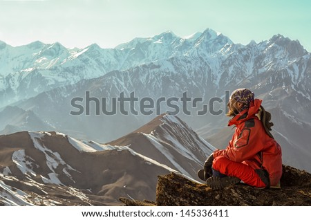 Man meditating in mountains - stock photo