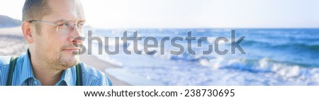 man middle age outside sea background panorama people - stock photo