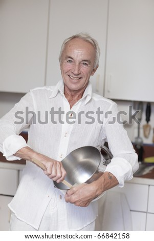 Man mixing something in the kitchen