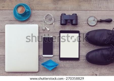 Man modern objects on wooden background. Adventure essentials for man. View from above - stock photo
