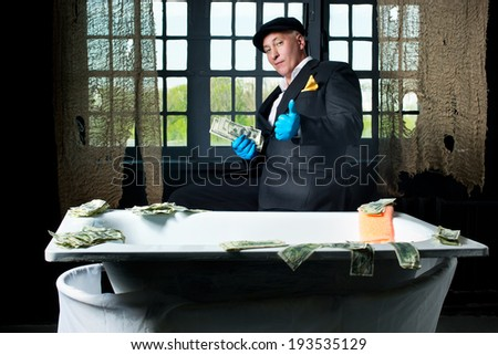Man money launderers in the bath - stock photo