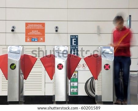 Man motion blurred entering the subway in Singapore - stock photo