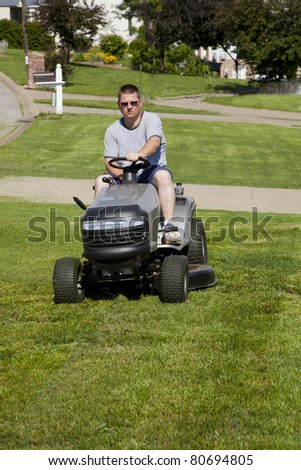 Man mowing his lawn at home, does not care for lawn care