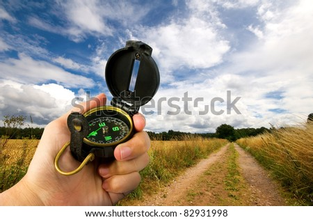 man navigating along a bridleway using a compass - stock photo